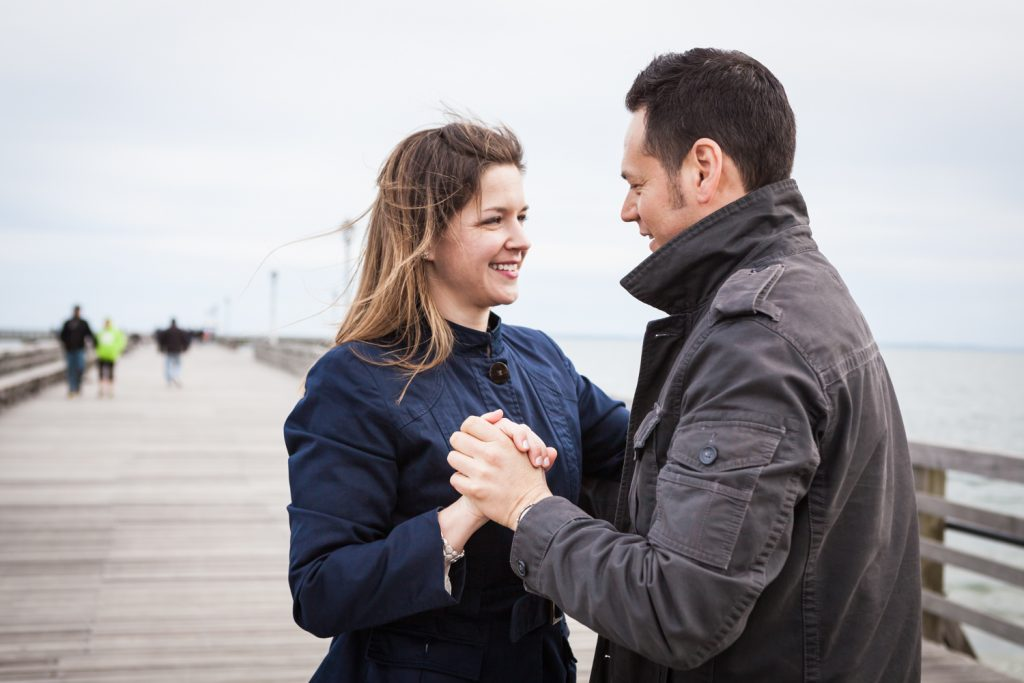 Couple dancing on Coney Island pier boardwalk