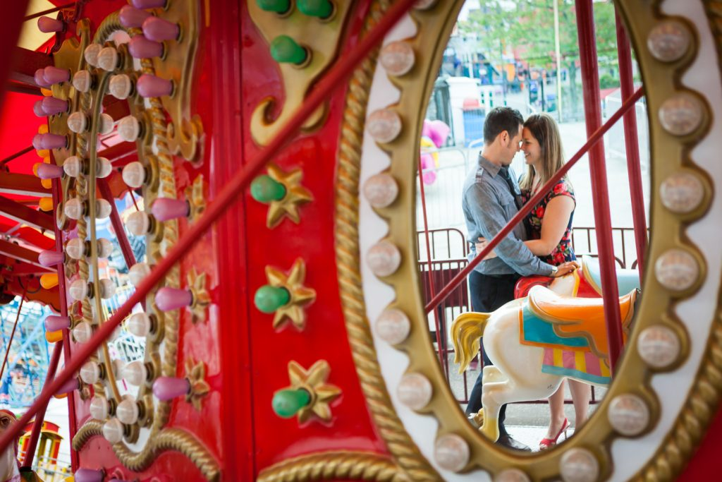 Reflection of couple in carousel mirror