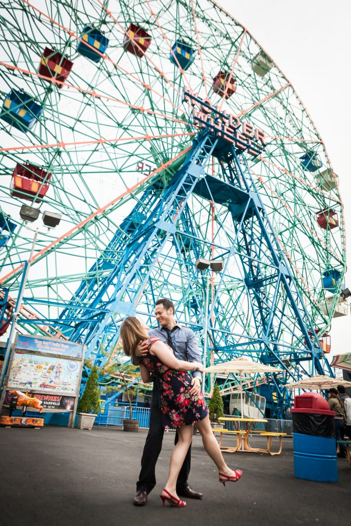 Couple dancing underneath Wonder Wheel at Coney Island