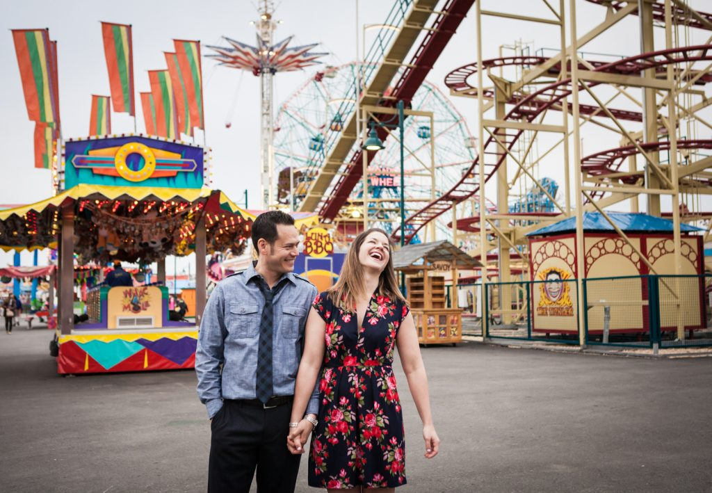 Couple standing in front of Luna Park at Coney Island
