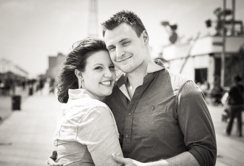 Black and white photo of couple on boardwalk