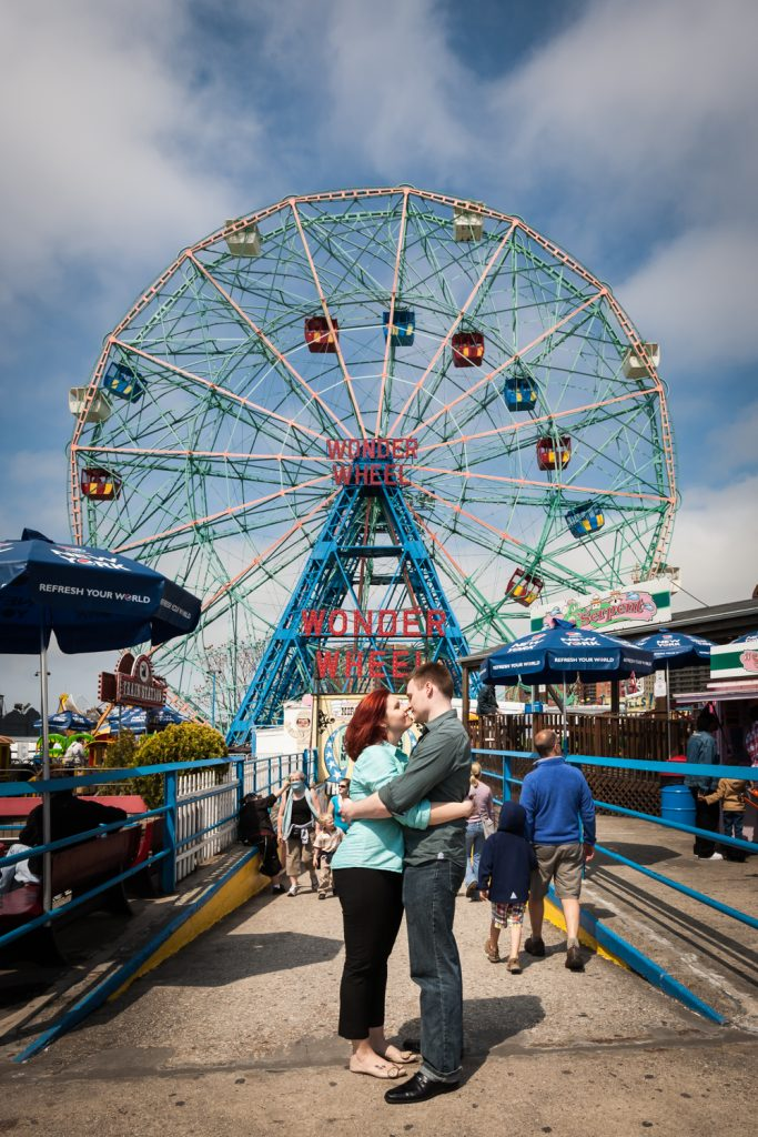 Coney Island engagement photos of couple in front of Wonder Wheel
