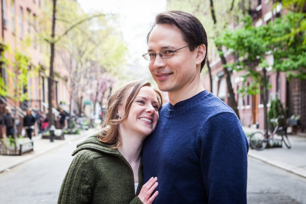 Couple hugging in middle of Greenwich Village street