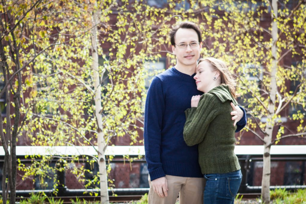 Couple hugging during a High Line engagement portrait session