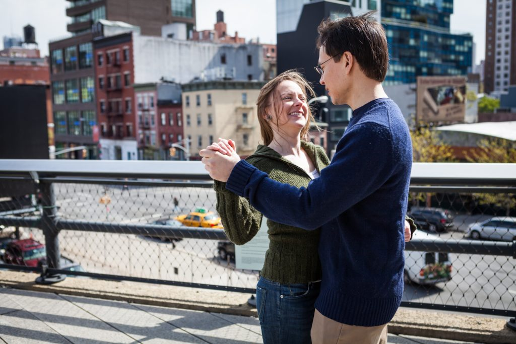 Couple dancing during a High Line engagement portrait session
