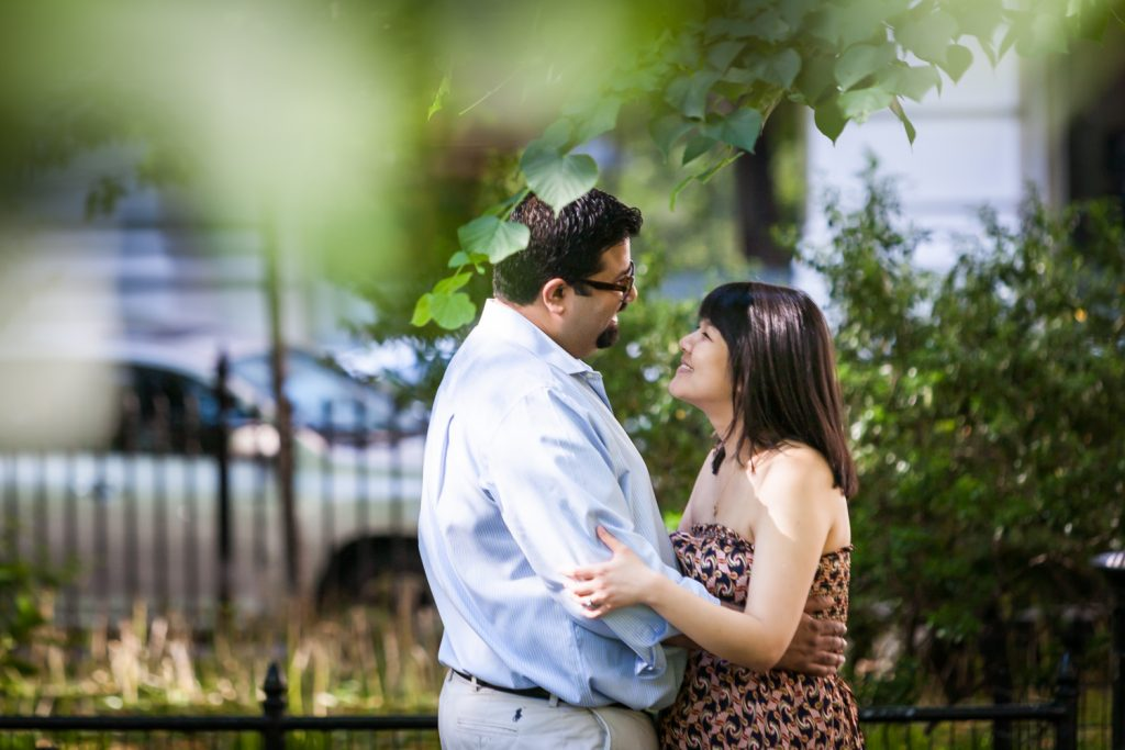 View through branches of couple in Madison Square Park