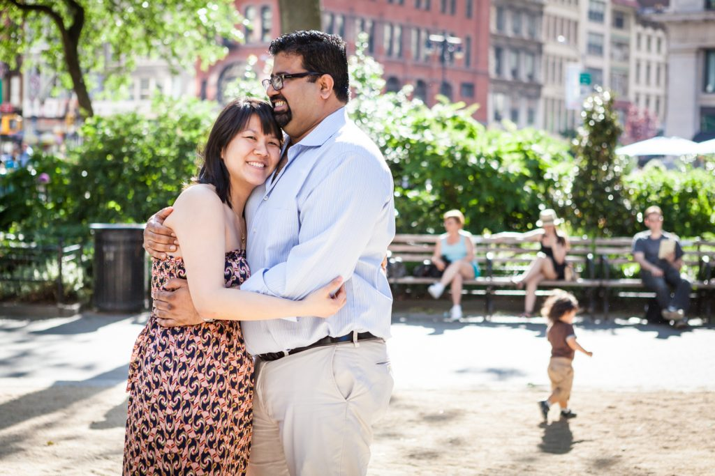 Couple hugging during a Madison Square Park engagement session