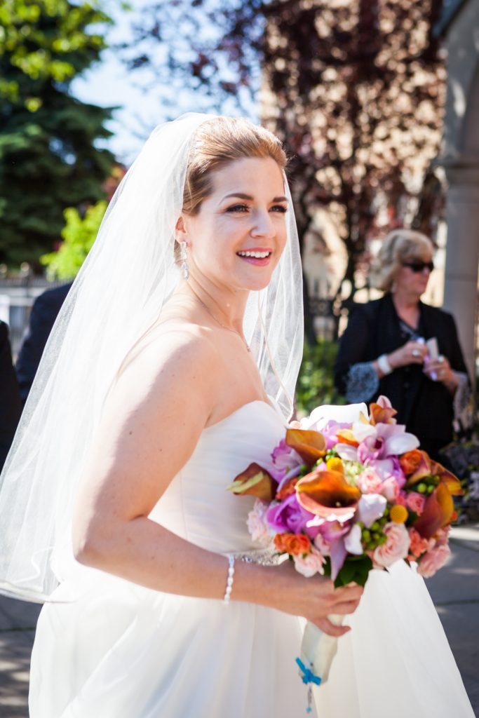 Bride wearing veil and bouquet after a Ravel Hotel Penthouse wedding