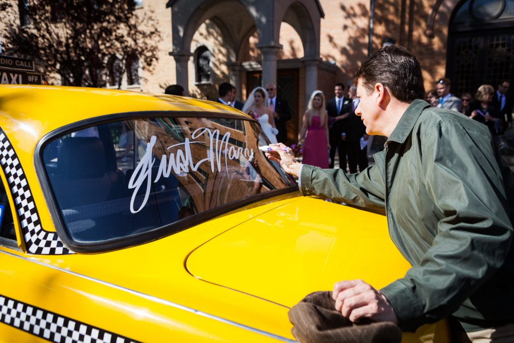 Driver writing 'just married' on old NYC taxicab