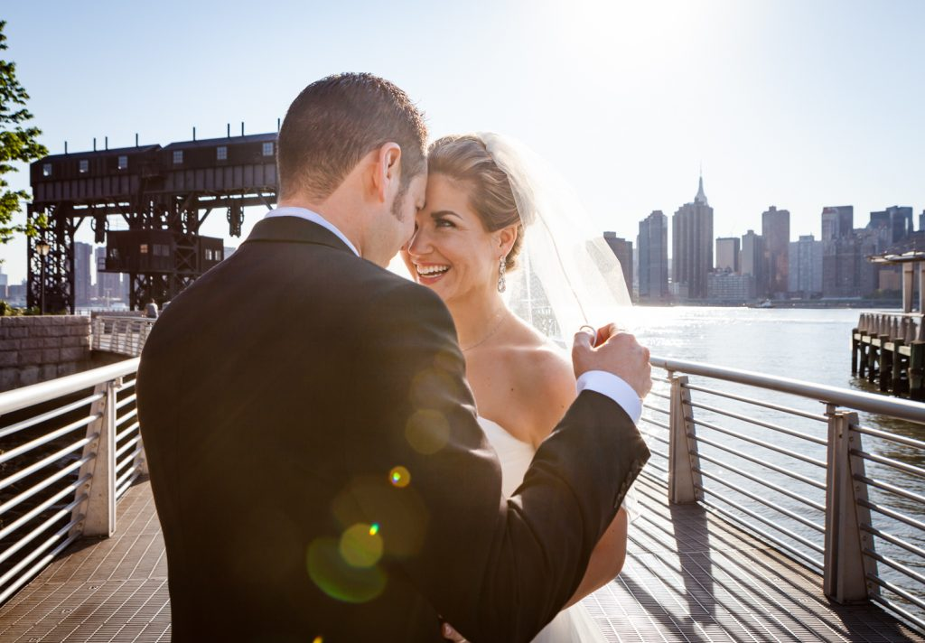 Bride and groom in Gantry Plaza State Park before a Ravel Hotel Penthouse wedding