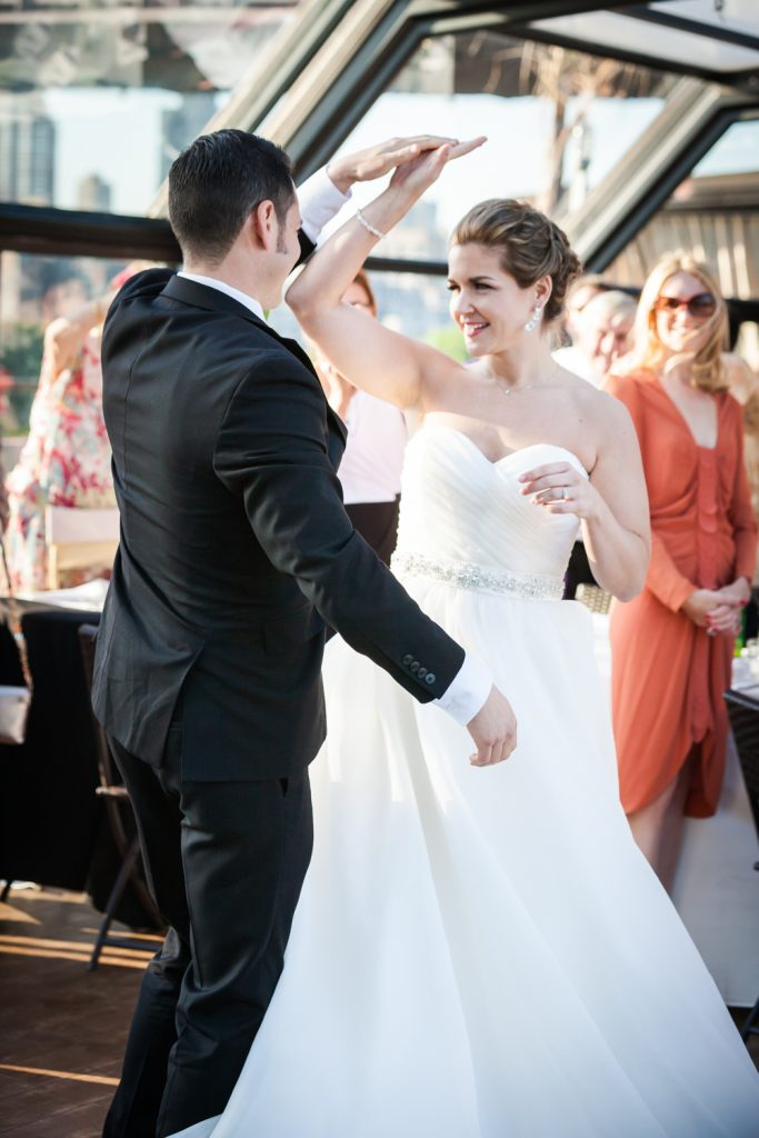 Bride and groom during first dance at a Ravel Hotel Penthouse wedding