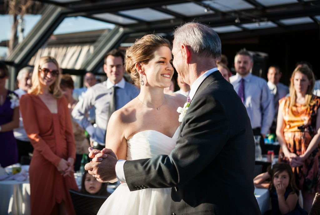 Father-daughter dance at a Ravel Hotel Penthouse wedding