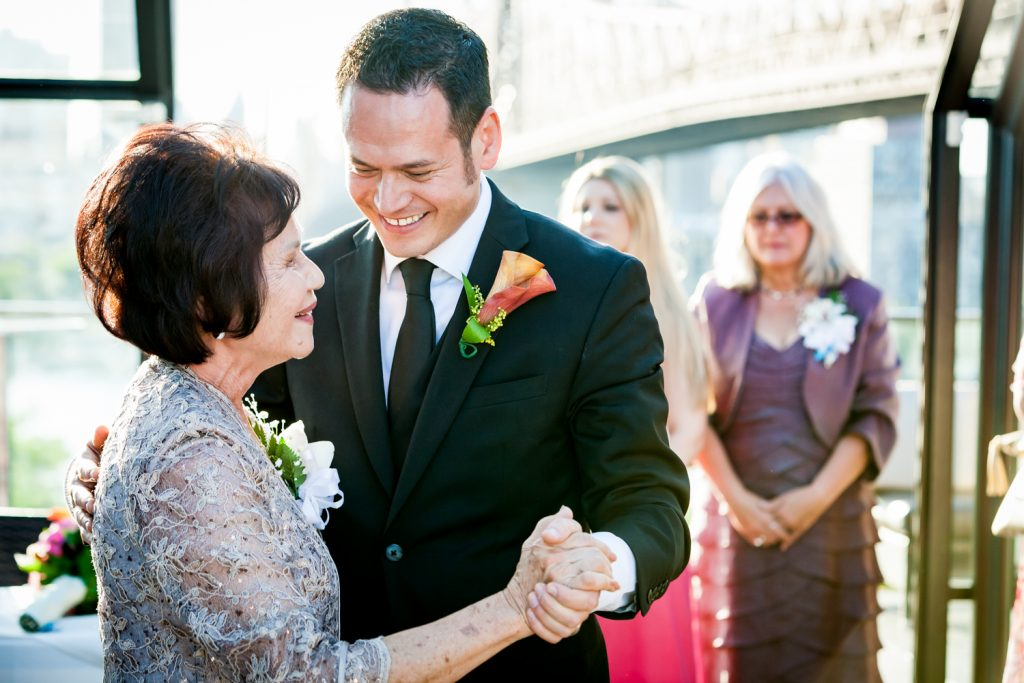 Mother-son dance at a Ravel Hotel Penthouse wedding