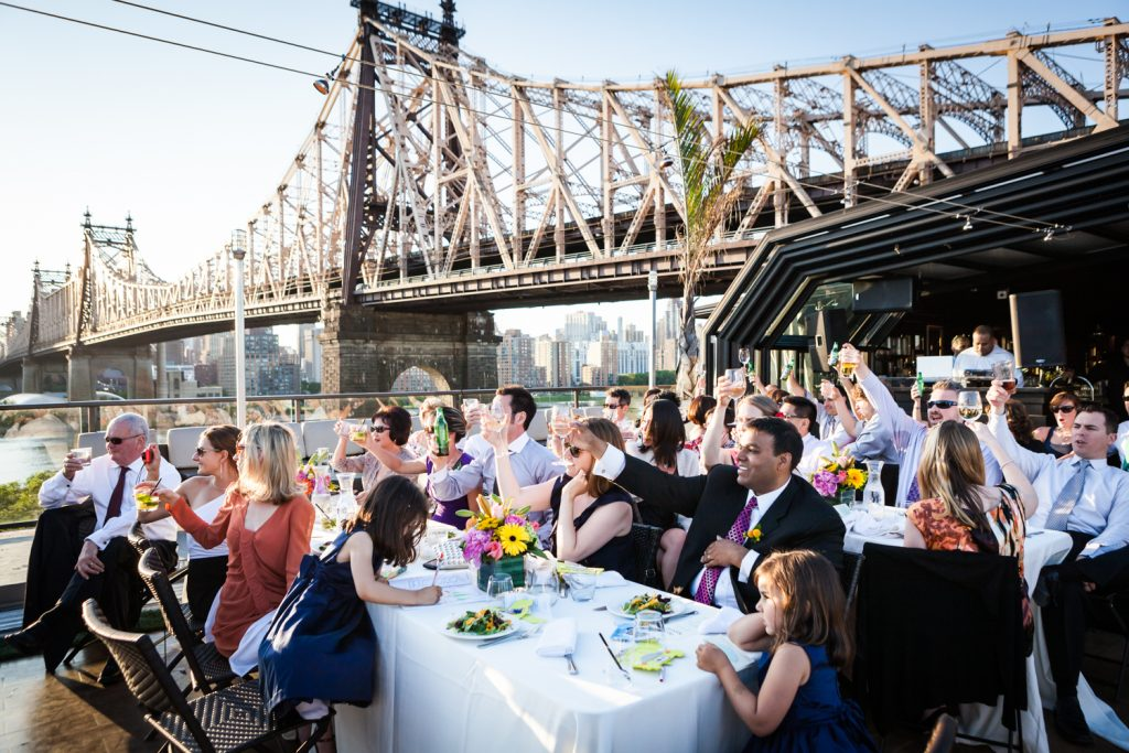Guests cheering with glasses at a Ravel Hotel Penthouse wedding