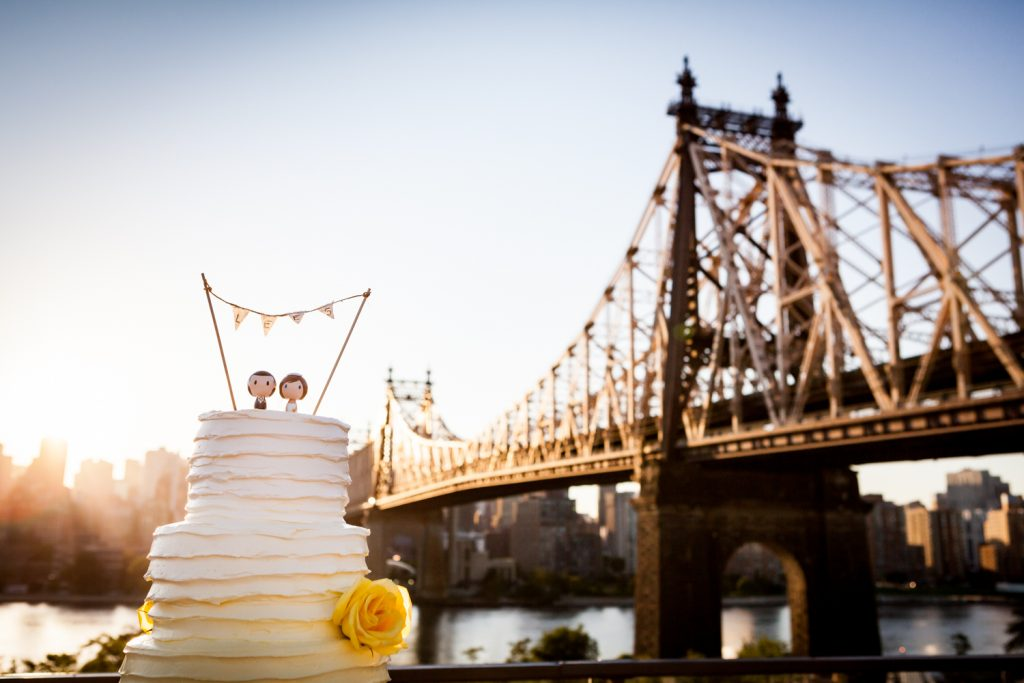 Wedding cake with Queensborough Bridge in background for a Ravel Hotel Penthouse wedding