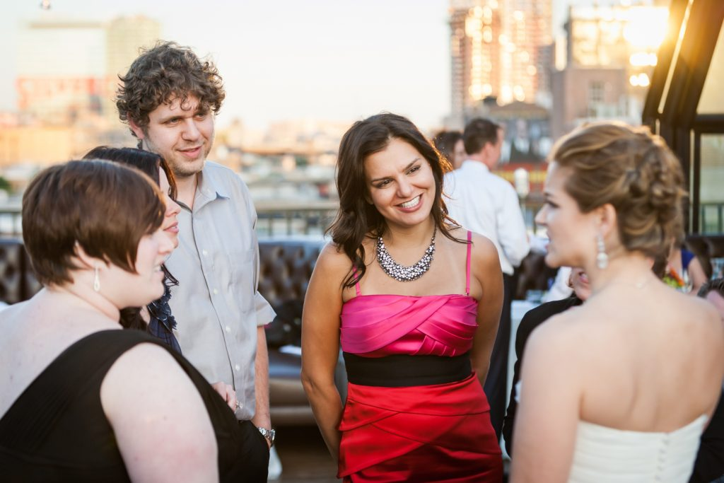 Guests talking with bride at a Ravel Hotel Penthouse wedding