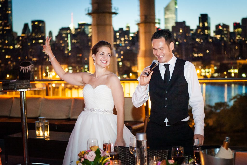 Groom giving speech at night during a Ravel Hotel Penthouse wedding