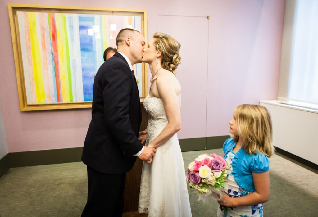 Kiss during a ceremony at a NYC City Hall wedding, by Kelly Williams