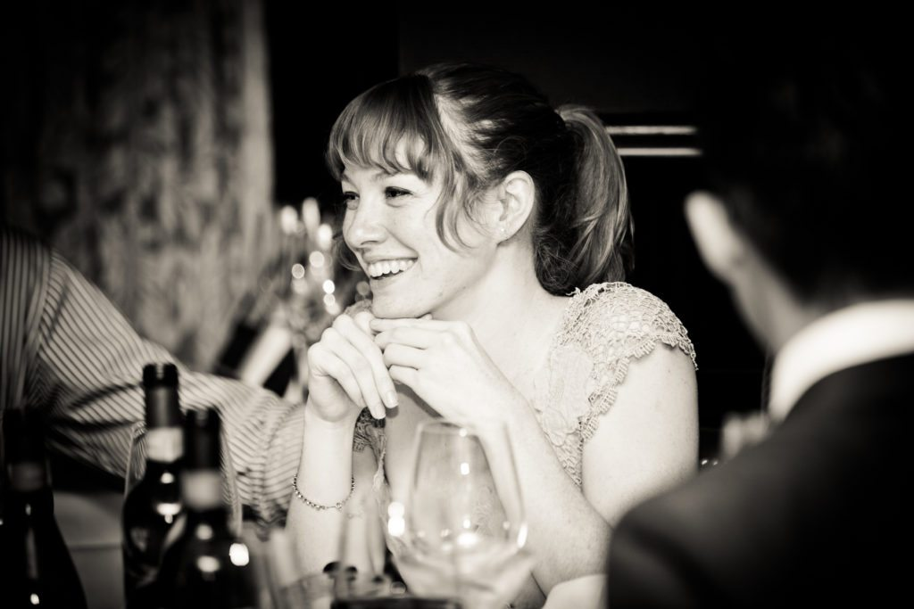 Guest enjoying a Capital Grill wedding reception, by Kelly Williams