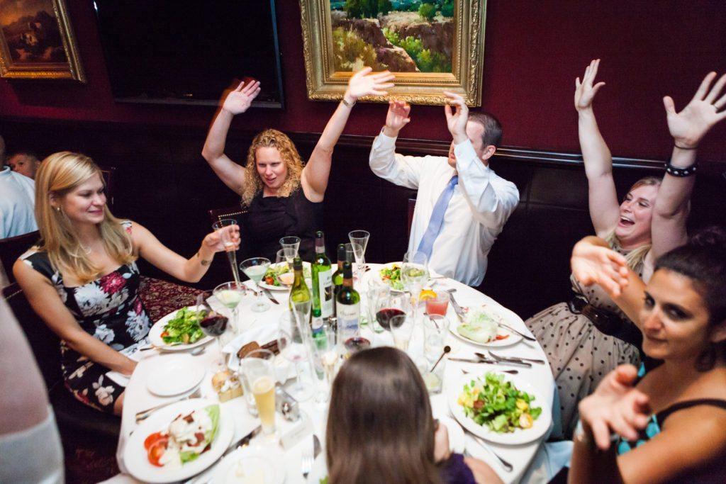 Guests enjoying a Capital Grill wedding reception, by Kelly Williams
