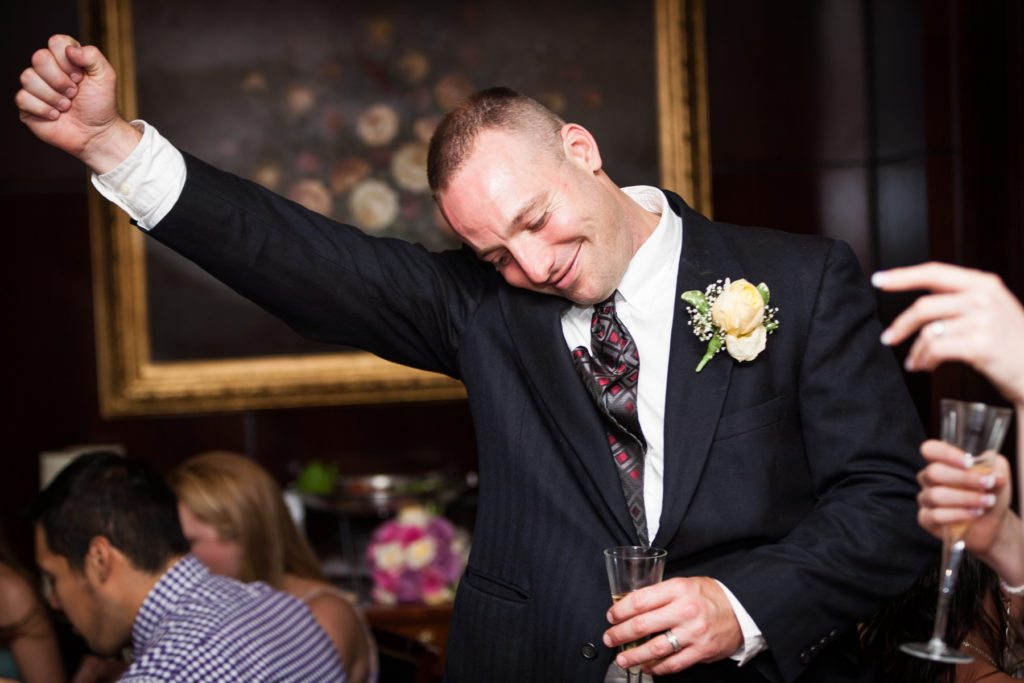 Groom enjoying his Capital Grill wedding reception, by Kelly Williams