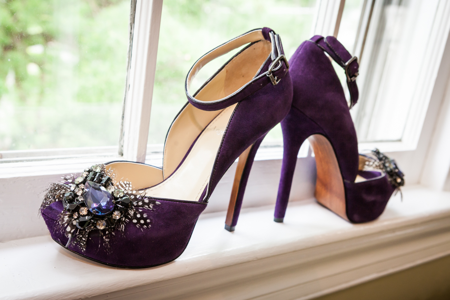 Close up on purple suede high heels with features