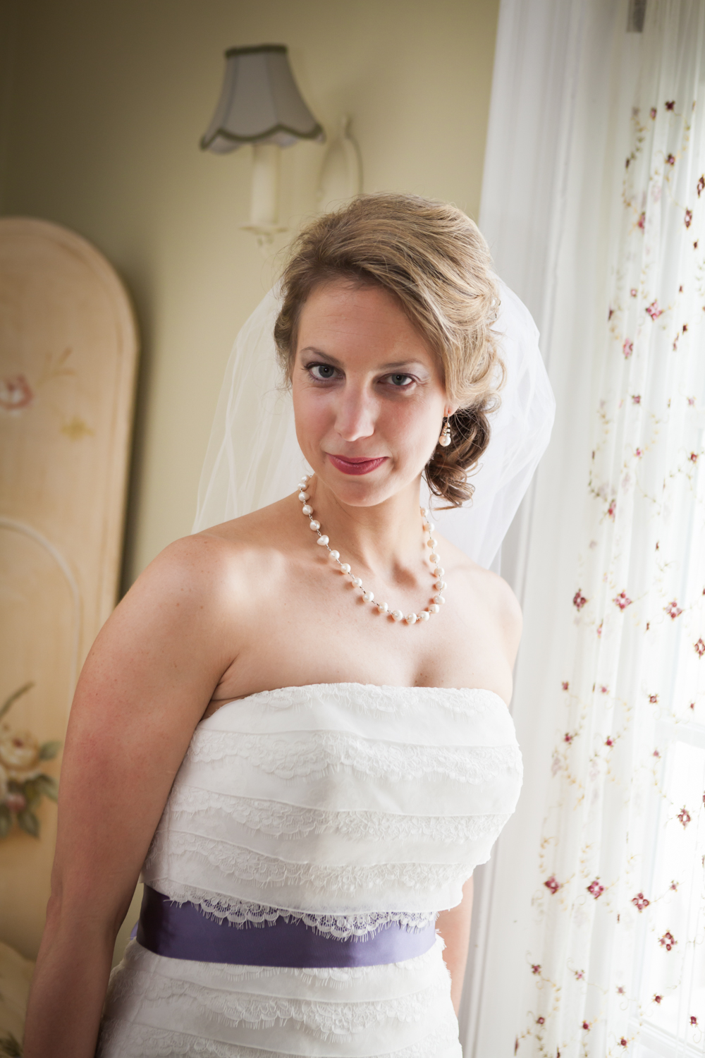 Portrait of bride with veil at a Davenport Mansion wedding
