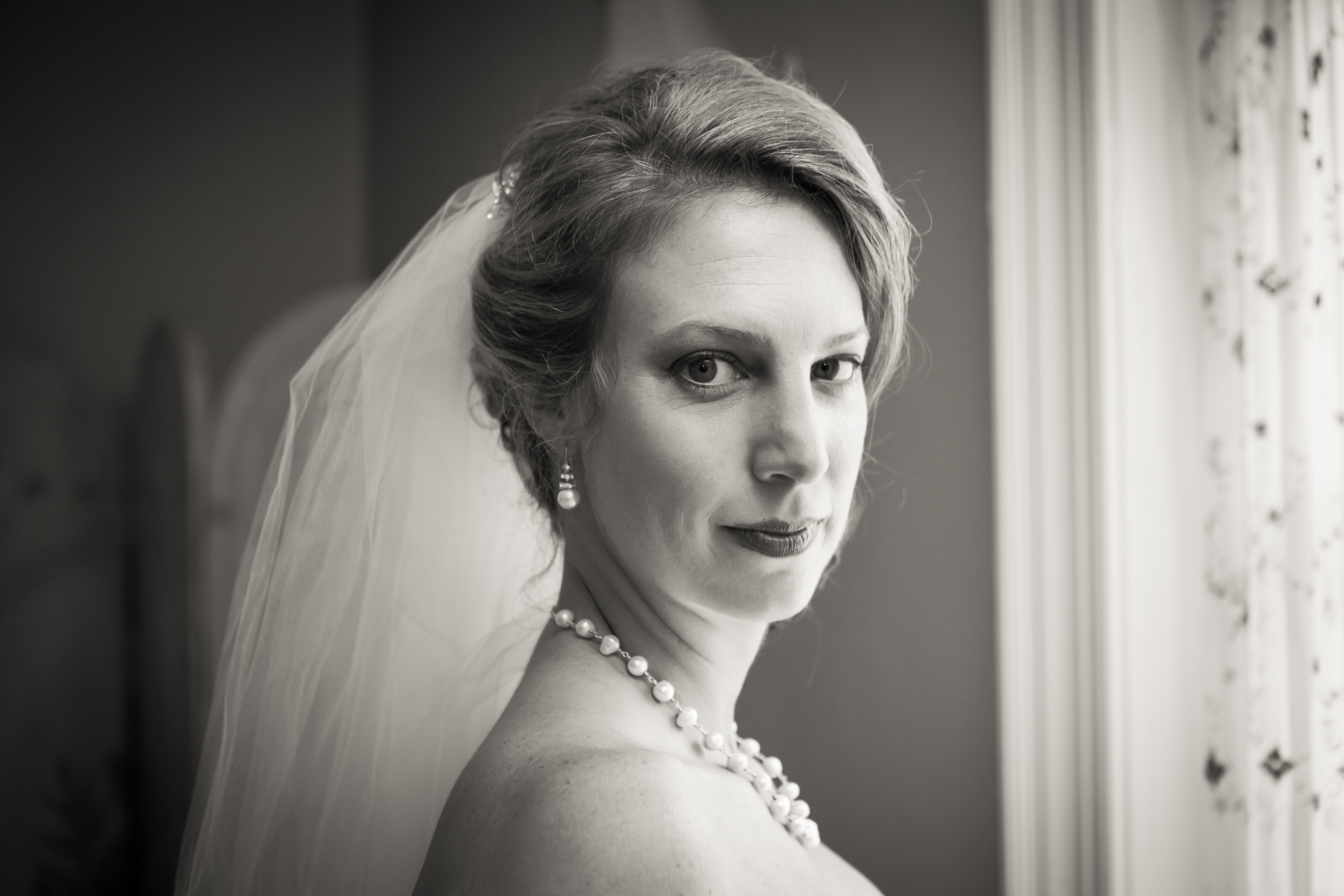 Black and white portrait of bride at a Davenport Mansion wedding