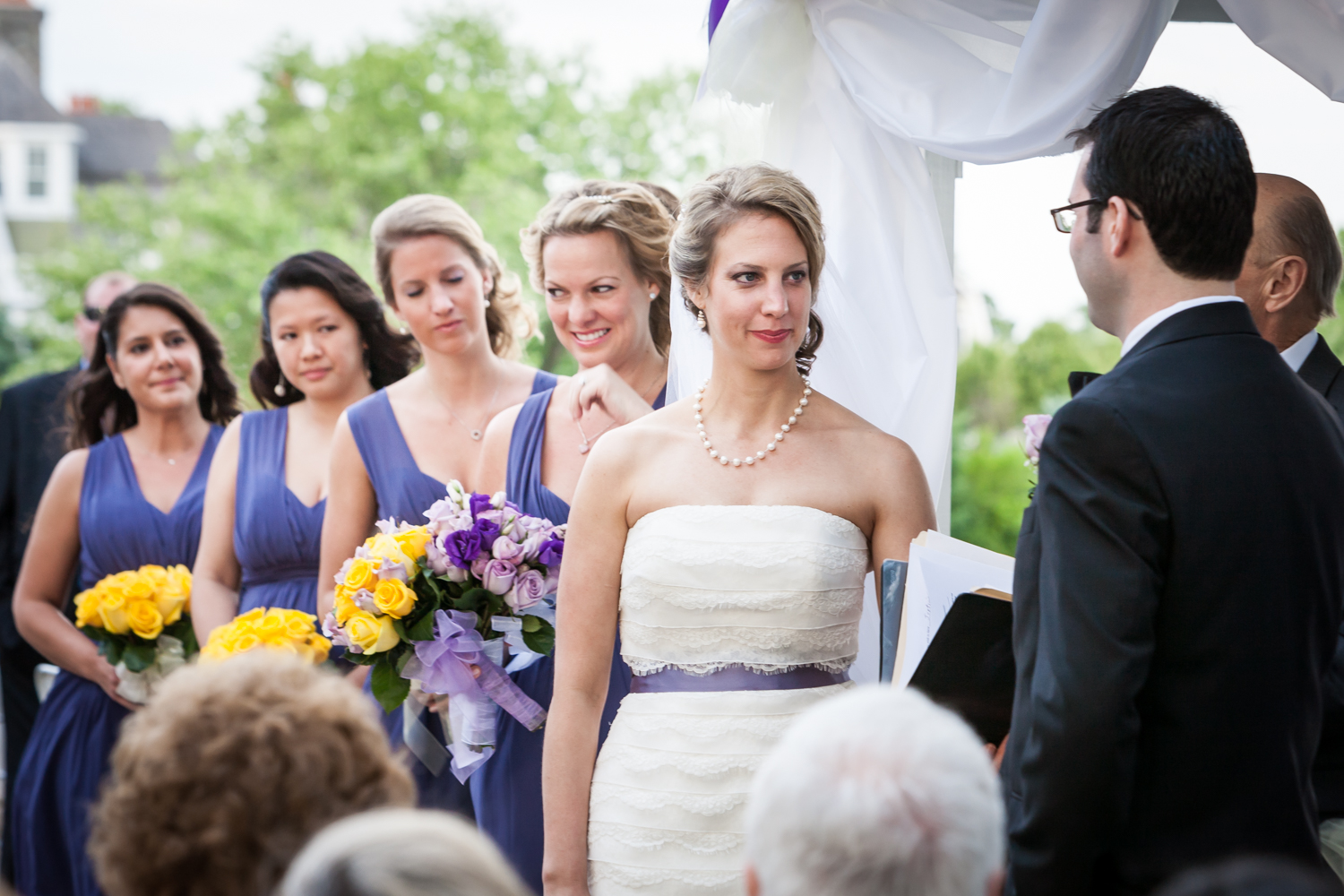 Bride and bridesmaids during ceremony at a Davenport Mansion wedding