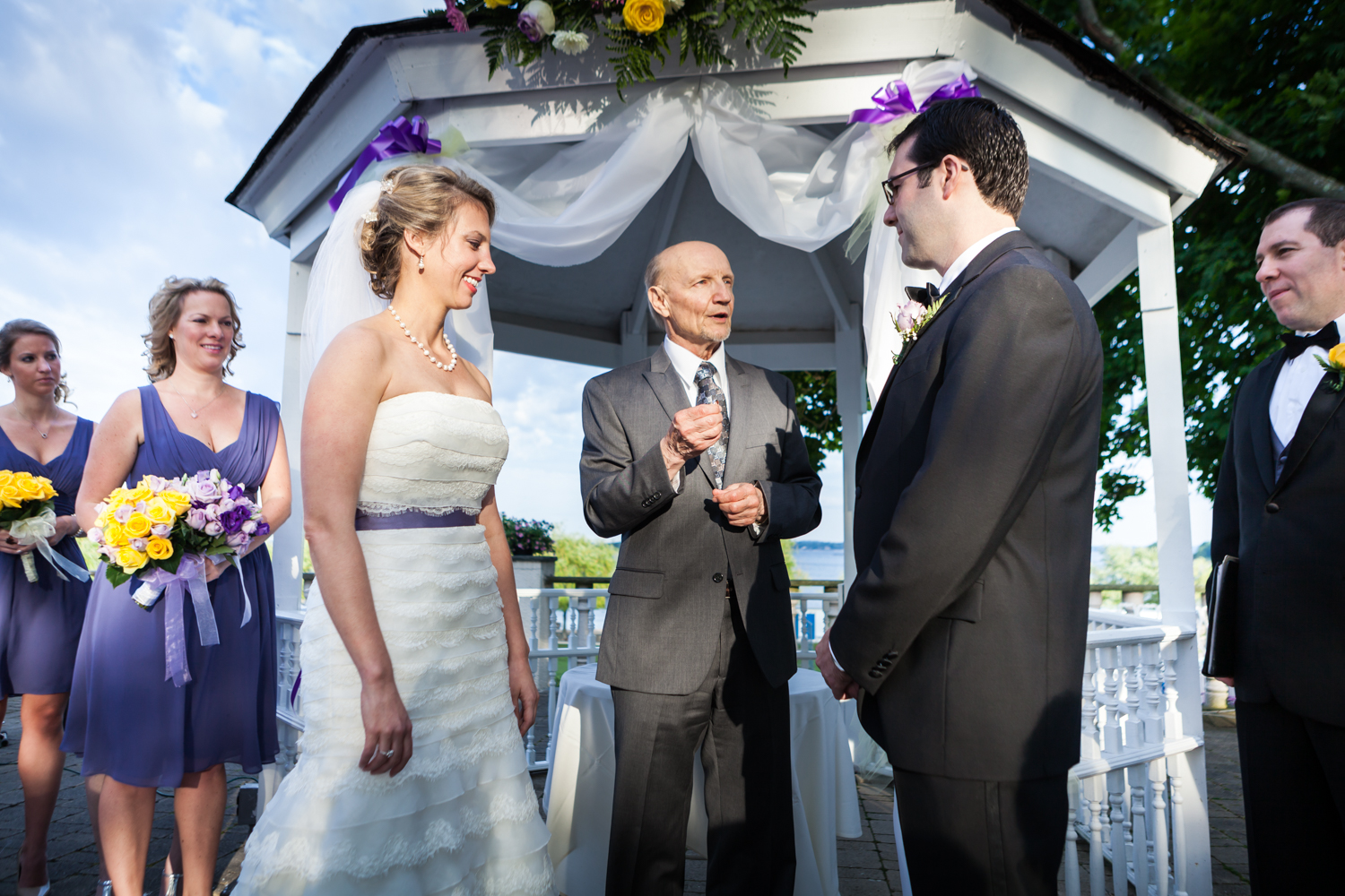 Officiant speaking to bride and groom at a Davenport Mansion wedding