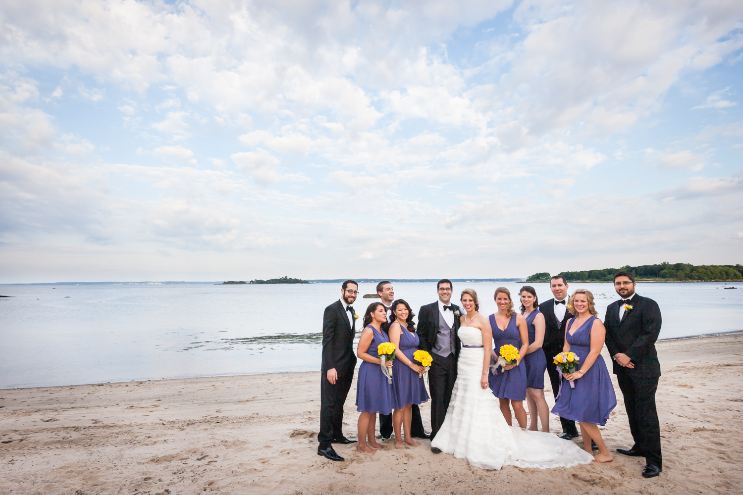 Bridal party on beach at a Davenport Mansion wedding