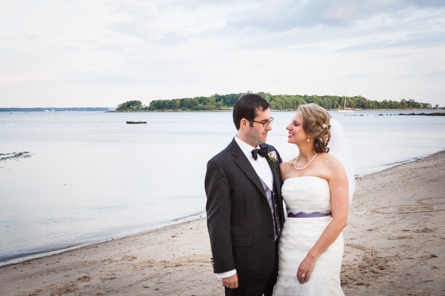 Bride and groom on beach at a Davenport Mansion wedding