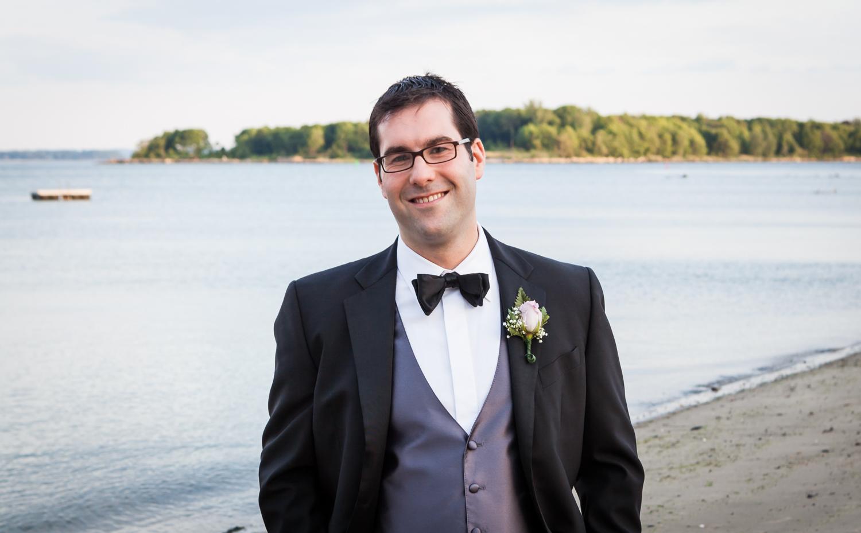 Groom on beach at a Davenport Mansion wedding