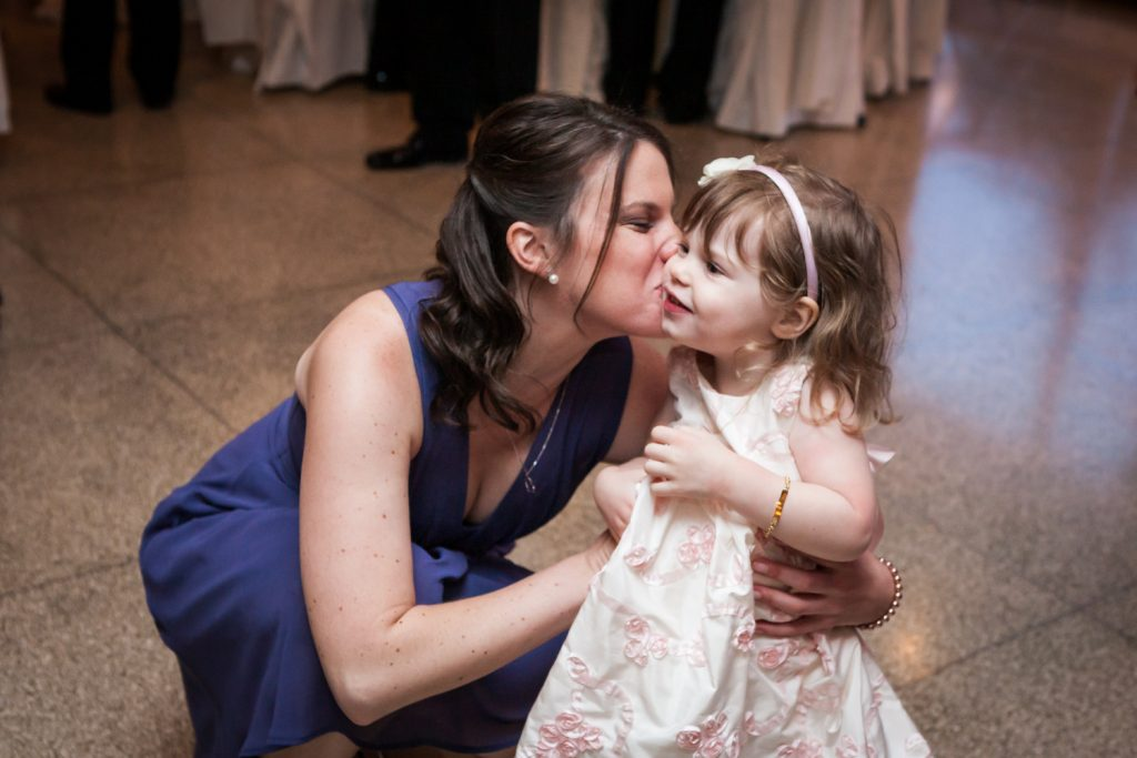 Woman kissing little girl on cheek at a Davenport Mansion wedding