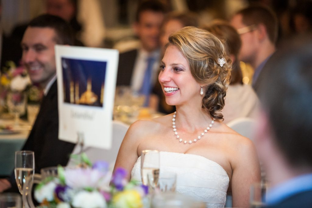 Bride laughing at speeches at a Davenport Mansion wedding