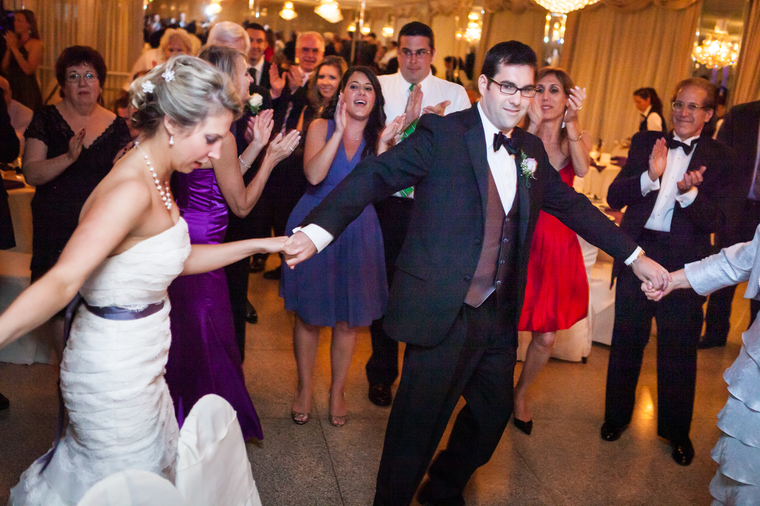 Bride and groom dancing in circle at a Davenport Mansion wedding