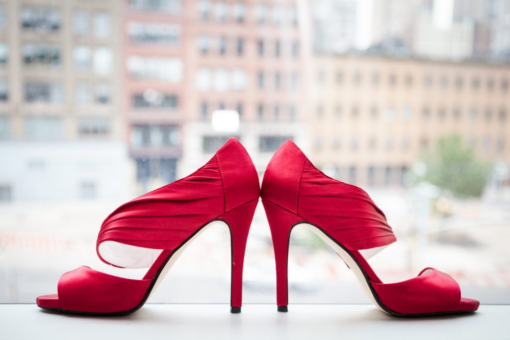 Red high heels in windowsill for a Merchant's House Museum wedding