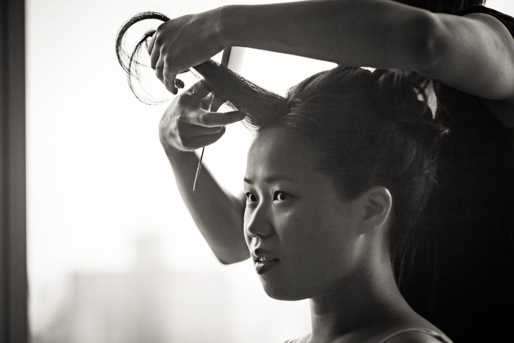 Black and white photo of bride getting hair curled