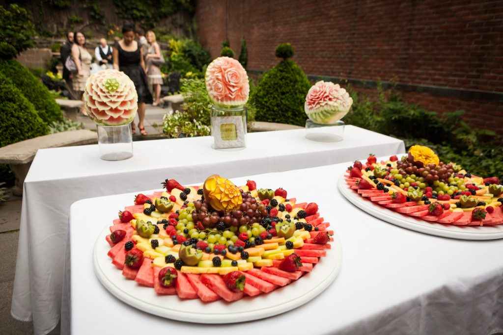 Plates of intricately carved fruit at a Merchant's House Museum wedding