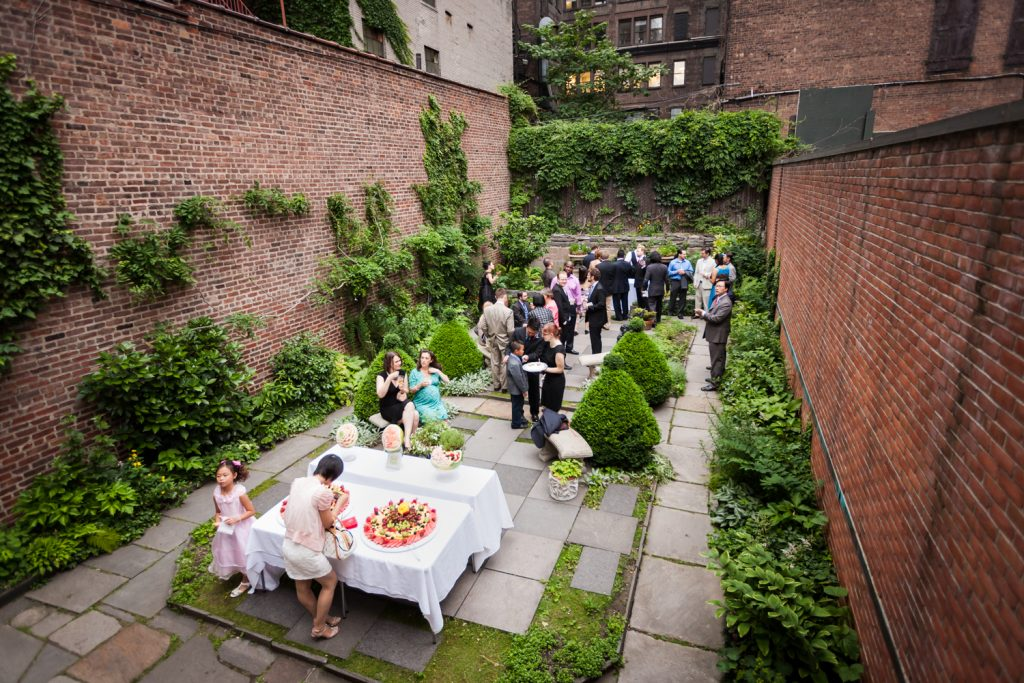 Wide shot of back garden patio at a Merchant's House Museum wedding