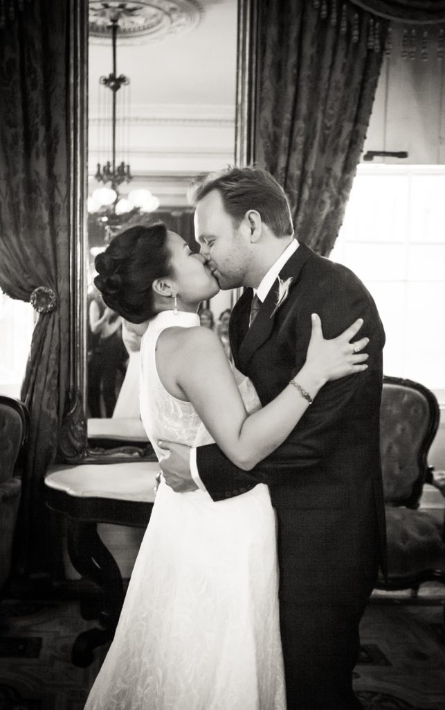 Black and white photo of bride and groom kissing at a Merchant's House Museum wedding