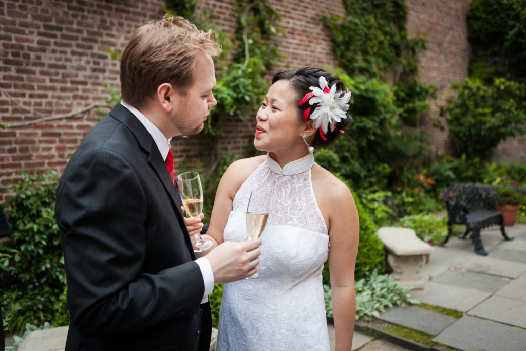 Bride and groom in garden patio at a Merchant's House Museum wedding