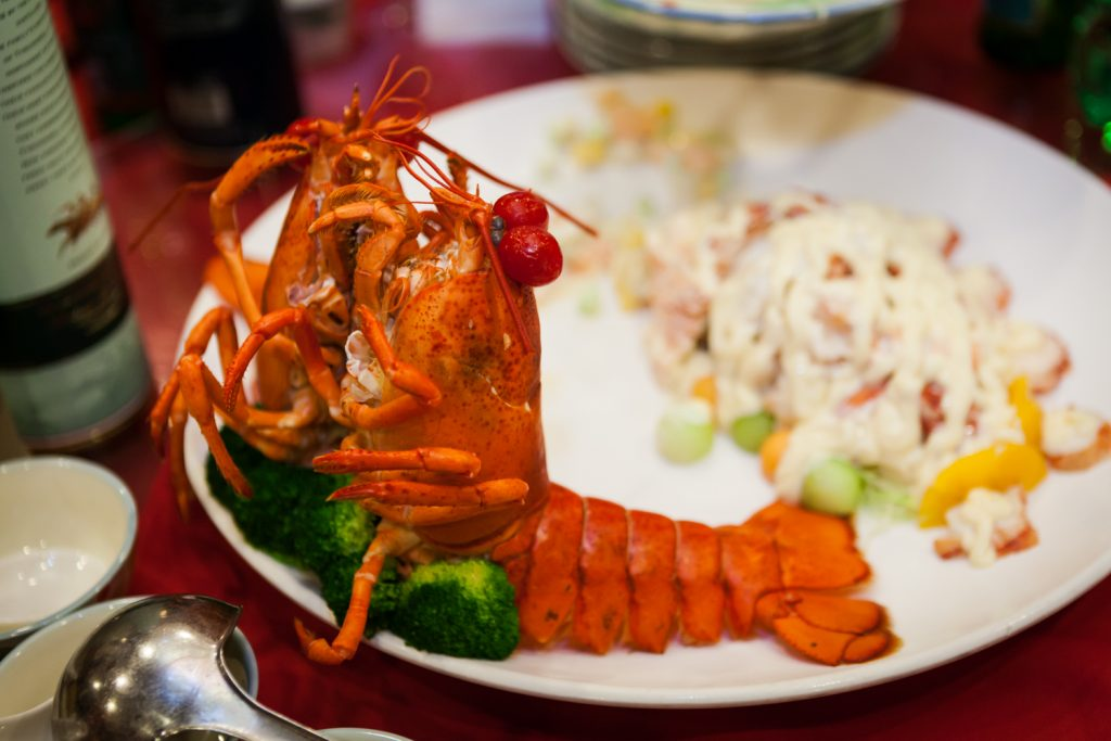 Close up on two lobsters on a plate at a Congee Village wedding reception