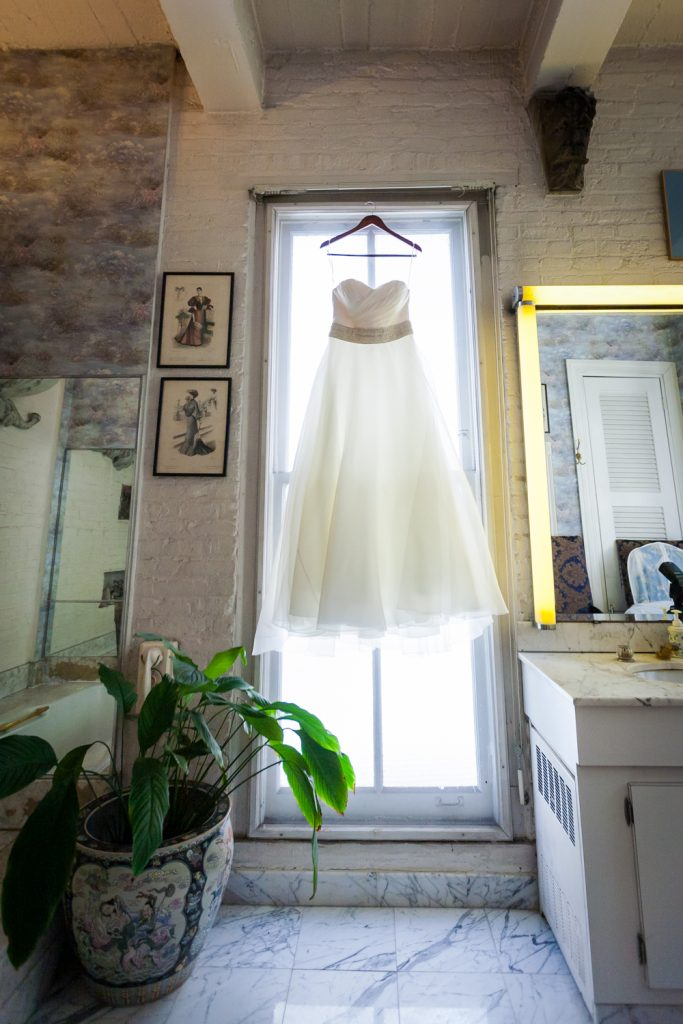 Wedding dress hanging in window at the Alger House