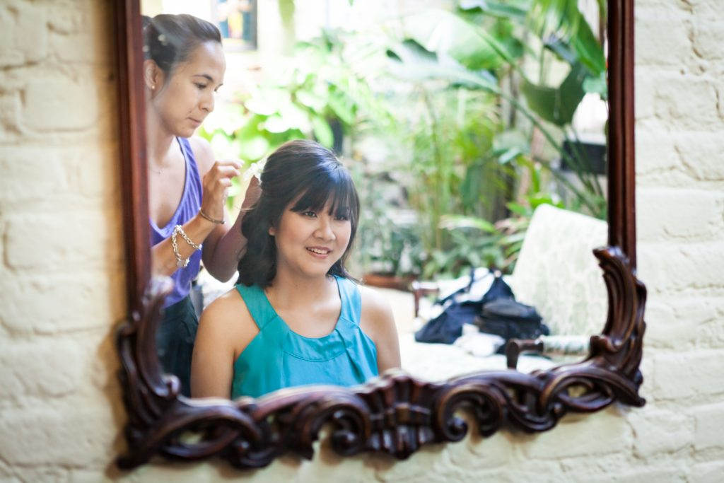Reflection in mirror of bride getting hair done at an Alger House wedding