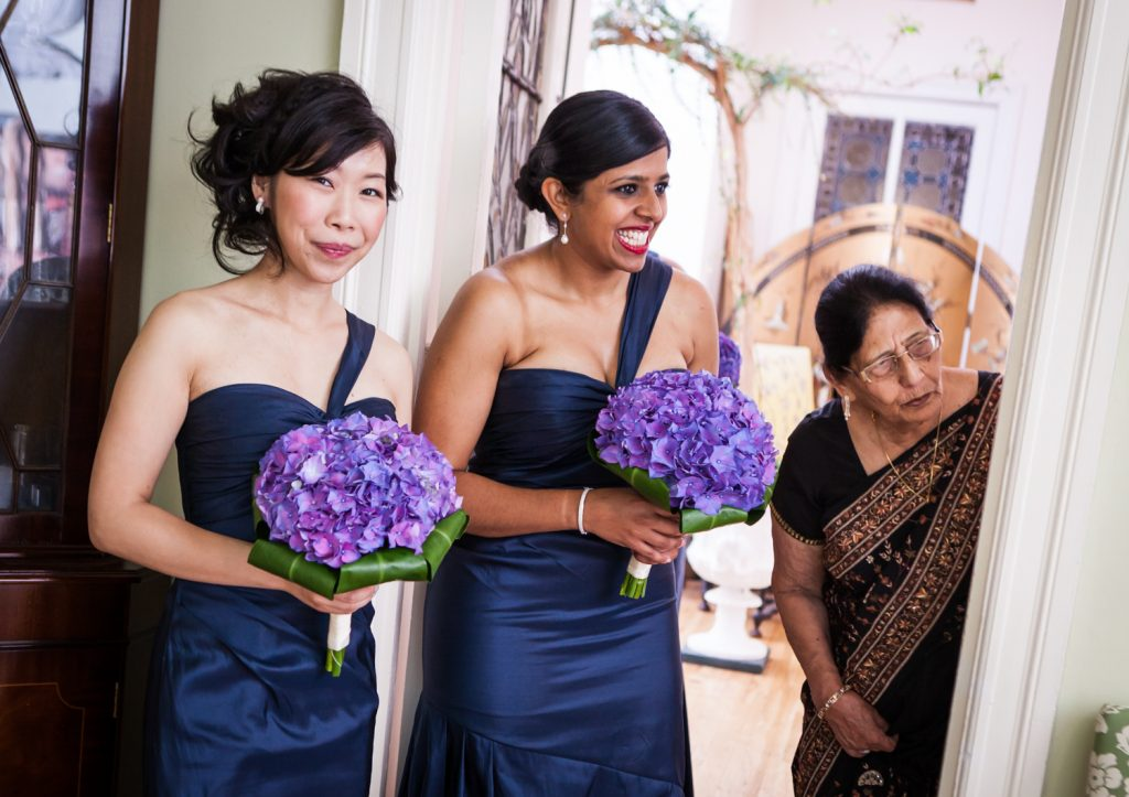 Bridesmaids and mother of groom looking in from doorway at an Alger House wedding