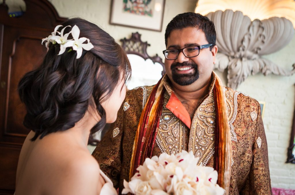 Groom seeing bride during first look at an Alger House wedding