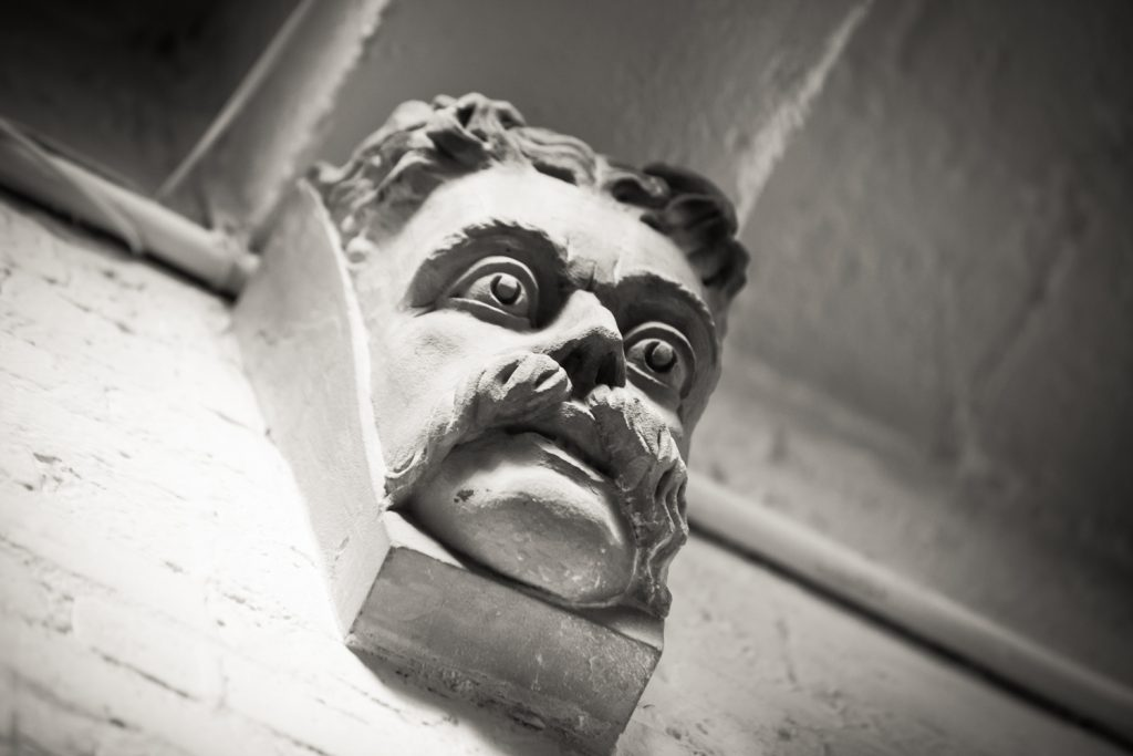 Black and white photo of Teddy Roosevelt wall decoration at the Alger House