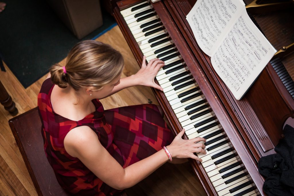 View overhead of woman playing piano