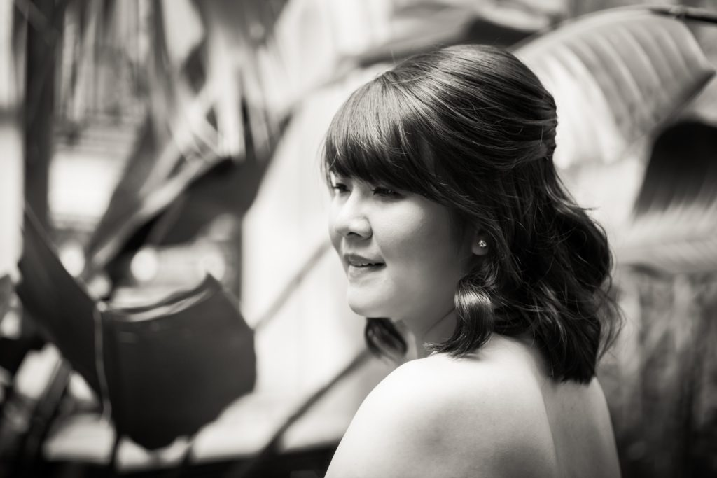 Black and white photo of bride looking over shoulder